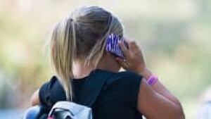 sm-220-girl-talking-cellphone-01192793