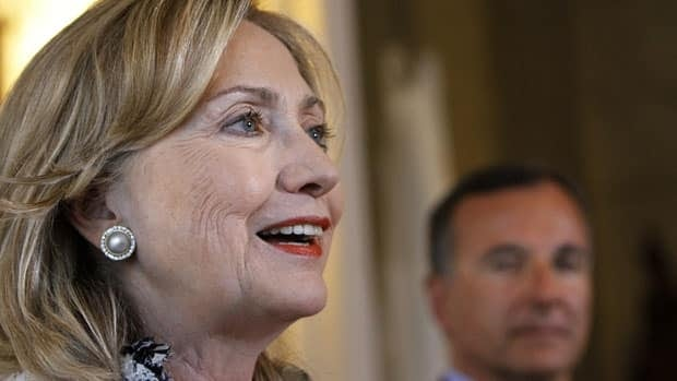 U.S. Secretary of State Hillary Clinton, left, talks to reporters in Rome on May 5, while Italian Foreign Minister Franco Frattini looks on. Clinton is attending the Arctic Council's ministerial meeting in Nuuk, Greenland, on Thursday.