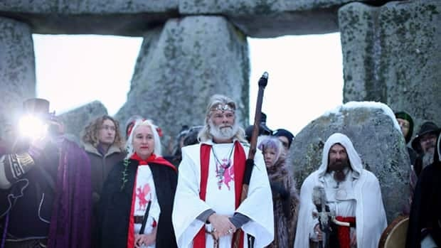 A group of Druids gather at Stonehenge in Wiltshire, England, to celebrate the winter solstice, the shortest day of the year.