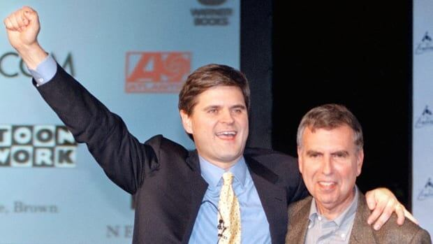 Steve Case, chairman and CEO of America Online, left, and Gerald Levin, chairman and CEO of Time Warner, rejoice after the announcement of the AOL Time Warner merger in January 2000, a monumental deal that would soon be known as one of the biggest business duds of all time.