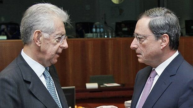 Italy's Prime Minister and Finance Minister Mario Monti, left, talks with European Central Bank  President Mario Draghi at the start of a European Union finance ministers meeting in Brussels on Wednesday.