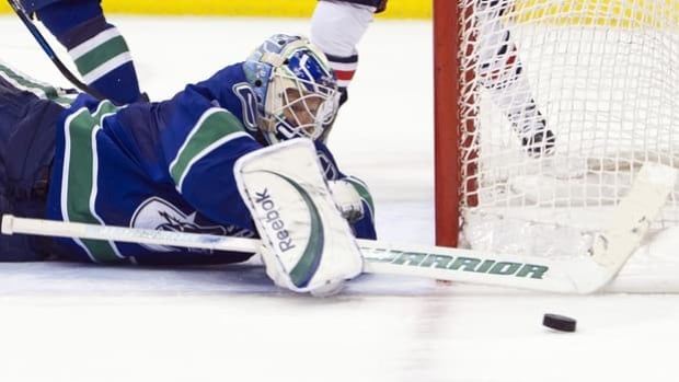 Canucks netminder Cory Schneider makes one of a career-high 47 saves in a 4-1 victory over the Blue Jackets on Tuesday.