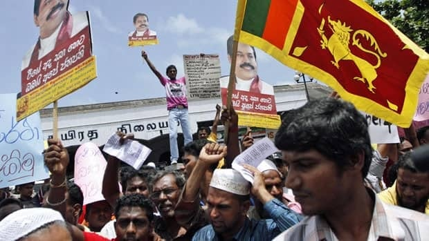Hundreds of Sri Lankan government supporters, including state-run media journalists, protested Aug. 2 in Colombo against the U.K.'s Channel 4 after the network aired a documentary with footage allegedly taken by front-line soldiers that appears to show blindfolded prisoners being shot at close range and the naked bodies of women being loaded into a tractor-trailer.