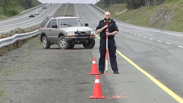 A Royal Newfoundland Constabulary officer collected measurements Tuesday after a crash that left a highway worker dead.