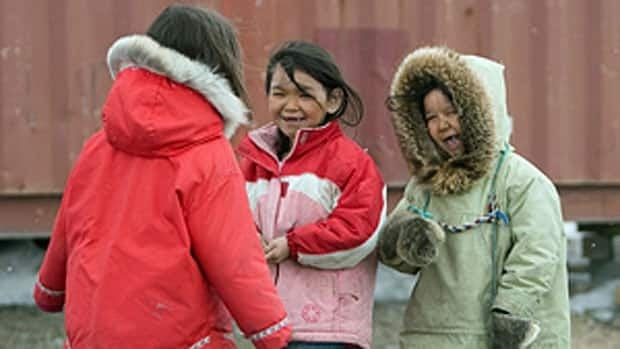 Children play together in Rankin Inlet, Nunavut, where the median age of 25,8 is the lowest in Canada, according to a Statistics Canada report released Wednesday.