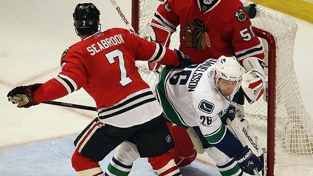 Canucks' Mikael Samuelsson (26) probably will see more of Blackhawks defenceman Brent Seabrook on Sunday night. Seabrook returns to the lineup after suffering a suspected concussion in Game 3 of their first-round playoff series.