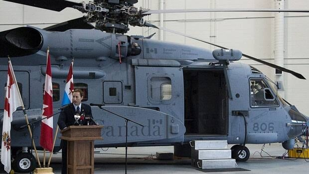 Defence Minister Peter MacKay addresses air crew and technicians after inspecting a new Cyclone helicopter in Halifax.