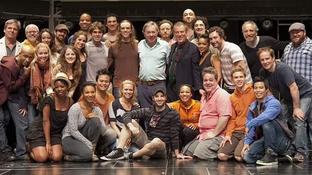 Andrew Lloyd Webber, seen at centre in the top row, poses with Stratford artistic director Des McAnuff (centre-right, top row) and surrounded by the cast of Jesus Christ Superstar at the Stratford Shakespeare Festival's Avon Theatre on Saturday.