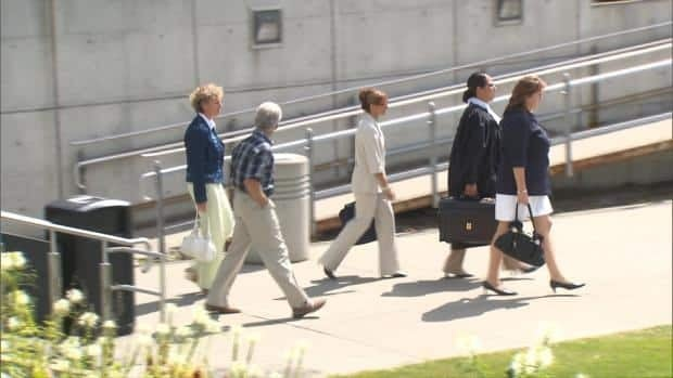 Pontbriand is standing trial on sex assault charges. She is seen here earlier this week (middle, in the beige suit.)