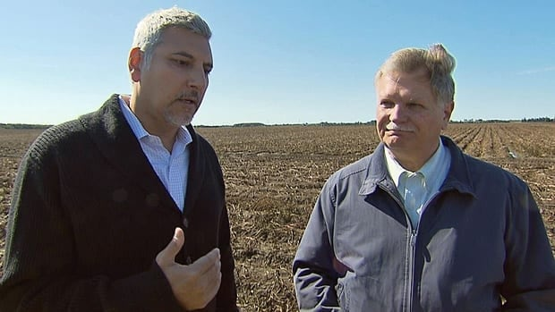 Joseph Izhakoff (left) and John Scherer (right) on the potato farm - and proposed quarry site - of Highland Companies in Melancthon Township, Ontario.
