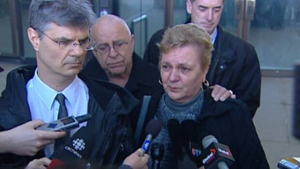 Johnny Altinger's brother Gary and his mother Elfriede speak to reporters outside the Edmonton courthouse Thursday.