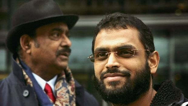 Former Guantanamo detainee Moazzam Begg, right, is seen with his father Azmat in this 2005 file photo.