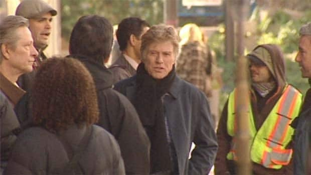 Hollywood legend Robert Redford was spotted in downtown Vancouver Tuesday, directing a film starring Chris Cooper, looking on from the far left.