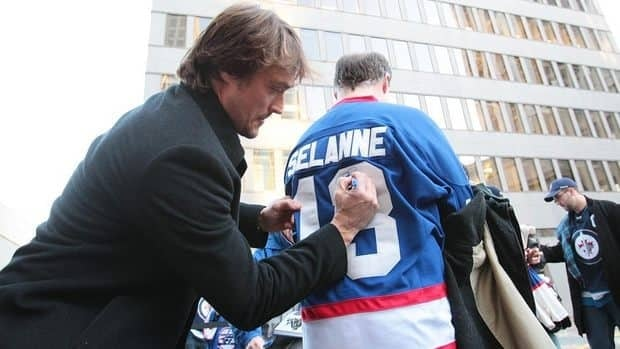 Teemu Selanne of the Anaheim Ducks greets fans as he leaves to take the bus to the MTS Centre on Saturday.