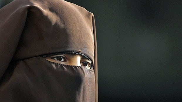 A Muslim woman wearing a niqab attends a protest against islamophobia and racism organized by the Islamic Central Council of Switzerland in Bern on Oct. 29.