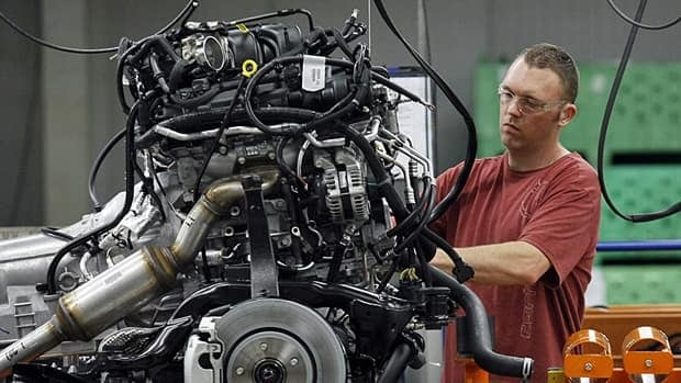 A Chrysler Group assembly worker works on the bottom chassis for Chrysler Jeeps, Grand Cherokees and Dodge Durangos at the Chrysler Jefferson North auto plant in Detroit.