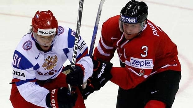 Canada defenceman Dion Phaneuf, right, is challenged by Russian forward Maxim Afinogenov during the quarter-finals of the world hockey championship Thursday in Bratislava, Slovakia.