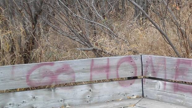 The graffiti at Mission March, which is only partially captured in this photo, had been on the bench for nearly a week. Authorities said it was cleaned off yesterday.