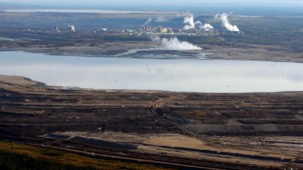 This Sept. 19 aerial photo shows a tar sands tailings pond at a mine facility near Fort McMurray, Alberta. A group of Nobel laureates has written to Stephen Harper to ask him to stop oilsands development.