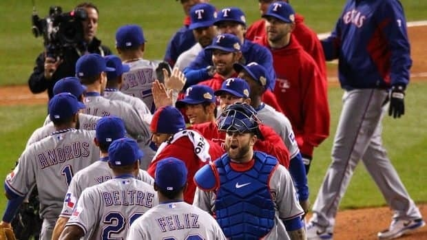 The Texas Rangers celebrate after defeating the St. Louis Cardinals 2-1 in Game 2 of the MLB World Series at Busch Stadium on Thursday.