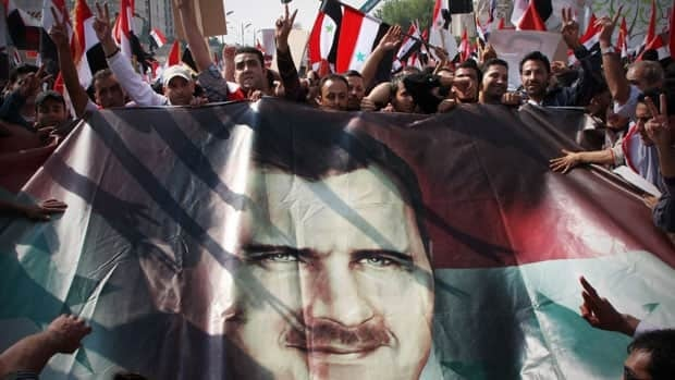 Some thousands of Syrians packed the square Wednesday in a show of support for embattled President Bashar Assad, a few hours ahead of a visit by senior Arab officials probing ways to start a dialogue between the regime and the opposition.