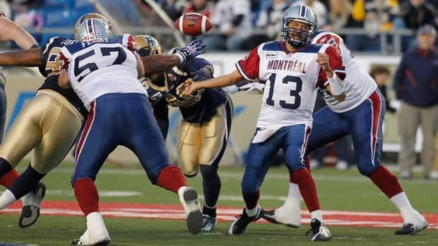 Montreal quarterback Anthony Calvillo (13) took a beating against Winnipeg but was still superb in the victory.