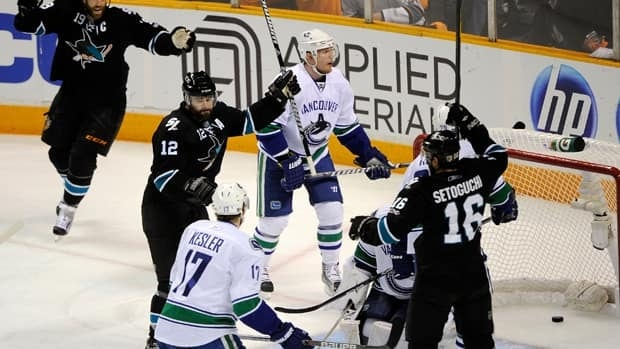 San Jose's Patrick Marleau, second left, celebrates his first of two goals in the opening period.
