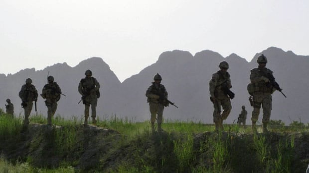 Canadian soldiers patrol an area in the Dand district of southern Afghanistan on June 7, 2009. Canada lowered its flag for the final time at Kandahar Airfield Thursday, marking the end of the military mission in southern Afghanistan.