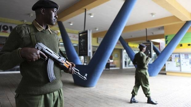 An administration policeman keeps guard outside a shopping mall in the suburbs of capital Nairobi on Oct. 25.