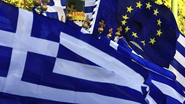 European leaders reached a deal Thursday morning on a plan to reduce Greece's debts by having private investors accept losses of 50 per cent on their bonds.