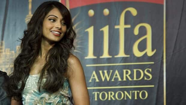 Bollywood actor Bipasha Basu smiles on stage during the 2011 International Indian Film Academy Awards press conference in Toronto on June. 23, 2011. The Ontario government spend almost $90,000 for artist fees during the three-day event.