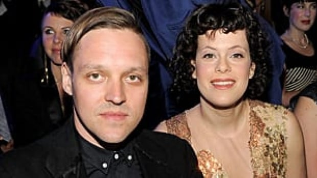 Grammy winners Win Butler, left, and Regine Chassagne of the band Arcade Fire, which took home album of the year.