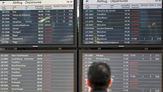 A passenger at Hamburg airport looks at the information board that shows most of the flights cancelled due to ash in the atmosphere stemming from Iceland's Grimsvotn volcano on Wednesday.