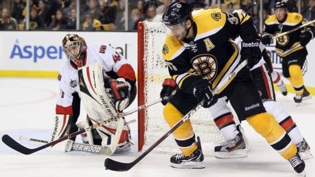 Bruins forward Patrice Bergeron (37) tries to score on netminder Craig Anderson in a 5-3 victory over the Senators on Nov. 1.