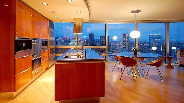 A lawsuit alleges faulty floor-to-ceiling windows at condos in Vancouver's landmark Wall Centre.