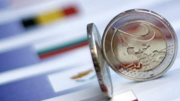 Two two-euro coins are seen on an identification sheet at an EU summit in Brussels on Friday.