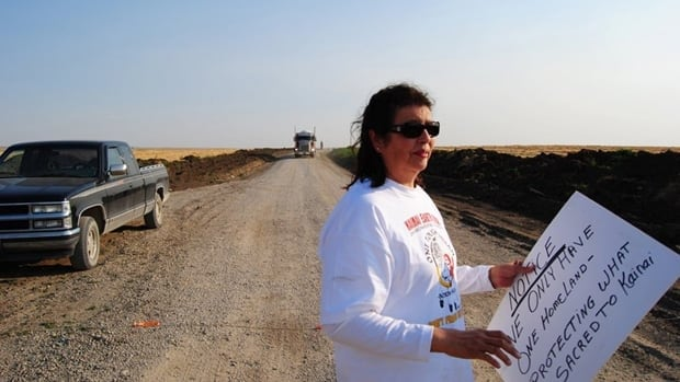 Lois Frank and a dozen members of the Kaiani Blood Tribe blocked trucks from Murphy Oil on a reserve road on Friday. Some members feel betrayed by their Chief and council who, without consulting tribal members, leased half of the Blood Tribe lands in southern Alberta to fracking operations.