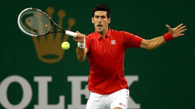 Novak Djokovic returns a shot to Jo-Wilfired Tsonga during the semifinals at the Qi Zhong Tennis Center on October 12, 2013 in Shanghai, China.