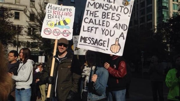 Concerned citizens rally against genetically modified foods in front of the Vancouver Art Gallery Saturday morning.