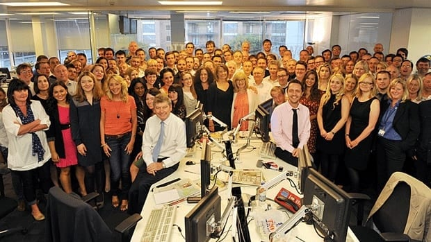 About 200 reporters and editors at the News Of The World are slated to lose their jobs as the paper shuts down over a growing phone-hacking scandal.