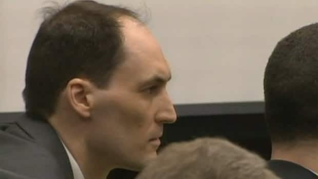 Brad Cooper listens to evidence at his first-degree murder trial on March 15, 2011.