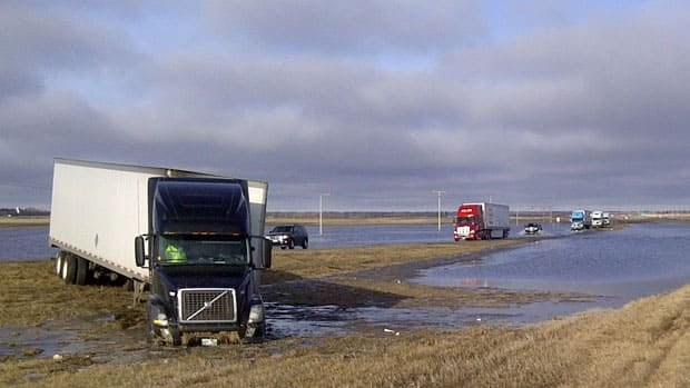 A semi is in the ditch at a water-covered section of the Trans-Canada Highway at Indian Head, Sask.