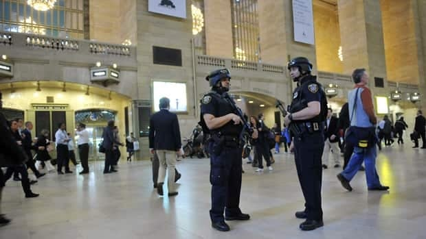 Armed Metropolitan Transportation Authority police officers stand guard in New York's Grand Central Station on Monday. Security was heightened as a result of Osama bin Laden's killing.