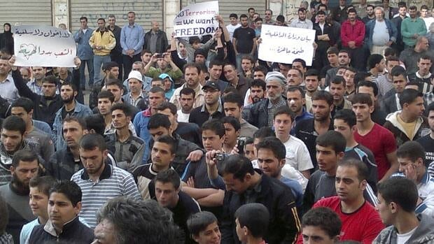 Protesters gather during a demonstration in the Syrian port city of Banias Wednesday. On Thursday, President Bashar Assad signed a law to end 48 years of emergency rule in Syria.