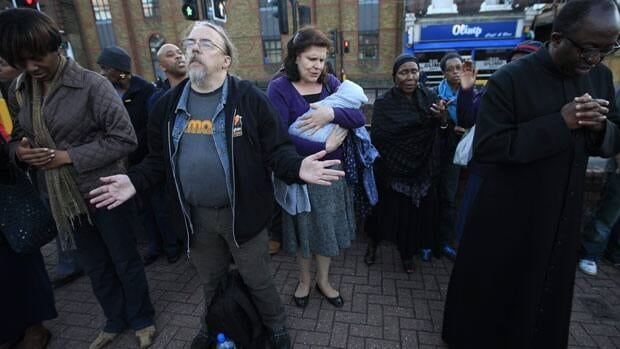 People pray for unity in the community on Aug. 11, in Tottenham, north London, where the riots started.