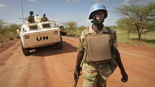 A Zambian UN peacekeeping soldier patrols the area in the contested border town of Abyei, Sudan. Stuart Price/Associated Press