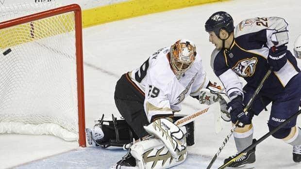 Nashville Predators right wing Jordin Tootoo scores against Anaheim Ducks goalie Ray Emery during Game 3 action.