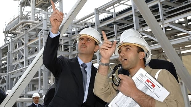 Syrian President Bashar Assad, left, tours the Ebla natural gas plant near Homs. The $1.2-billion Suncor facility provides electricity to 10 per cent of homes in Syria.