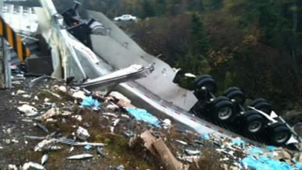 A tractor-trailer carrying a load of fish crashed east of Clarenville on Monday night.