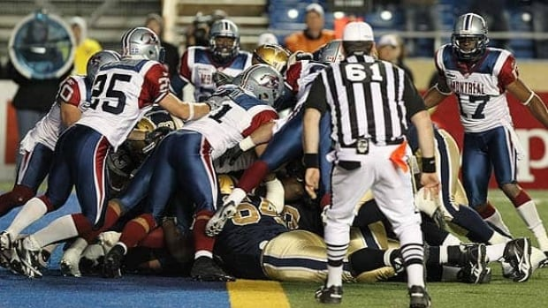 Montreal Alouettes defenders stop the Winnipeg Blue Bombers in a goal-line stand late in Friday's game at Canad Inns.